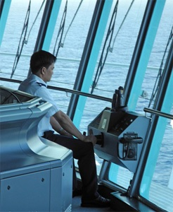 Cruise ship Quartermaster (Helmsman) on the bridge