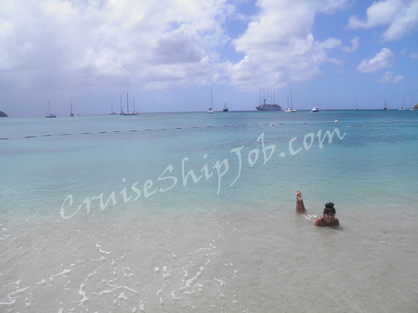 Hired cruise job seekers photos - Windstar Cruises crew member on the beach in St. Lucia